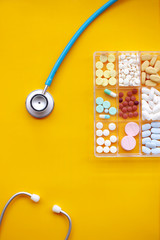 Different medication with stethoscope for background