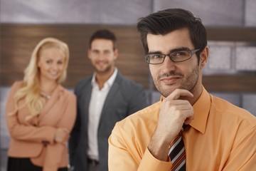 Closeup portrait of smiling businessman