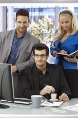 Elegant businesspeople working in team