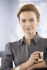 Closeup portrait of businesswoman with coffee