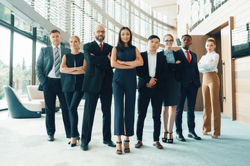 Successful team of young perspective businesspeople in office
