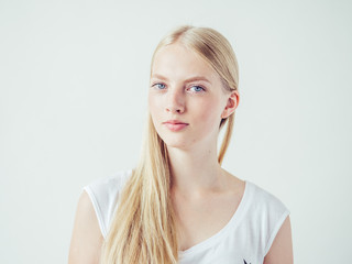 Blonde woman with long smooth hair natural portrait