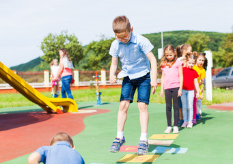 Fototapeta Entertaining physical education lesson in the summer outdoors obraz