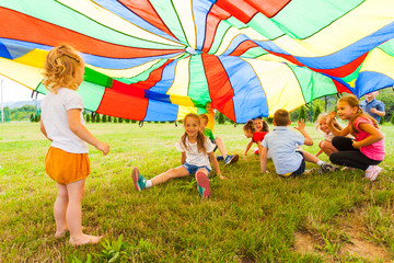 Funny games under colorful canopy in the summer outdoors