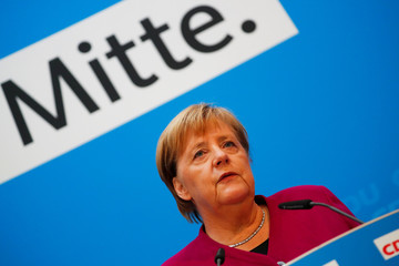 German Chancellor Angela Merkel gives a statement at the CDU headquarters in Berlin