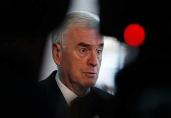 The Labour Party's shadow Chancellor of the Echequer John McDonnell speaks to journalists as he arrives at the party's conference in Liverpool