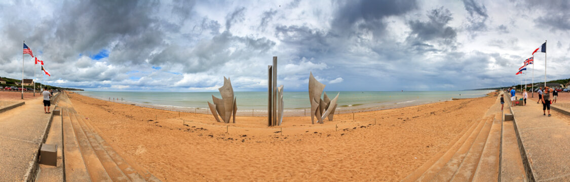 Beautiful panorama of WWII monument Les Braves, on the center of Omaha Beach in Normandy, France, with clouds in summer