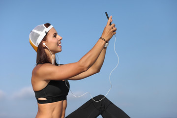sporty young girl with phone and headphones