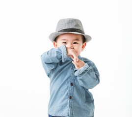 One year old Asian baby boy in jeans shurt look at camera  isolated on white background studio close up shot.