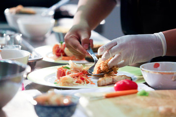 Chef preparing food, meal, in the kitchen, chef cooking, Chef decorating dish, closeup,