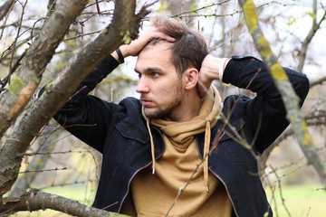 Young beard man in an autumn