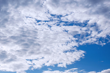 White clouds on a blue sky in clear weather.