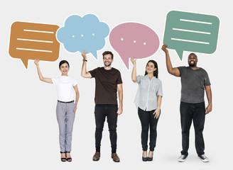 Diverse people holding speech bubble symbols