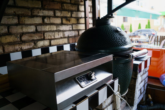 kitchen of the restaurant is equipped with an expensive ceramic grill oven and an electric stove near the window. Close-up