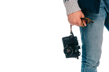 close-up partial view of man holding camera isolated on white