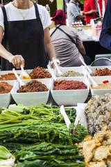 Sauces in bowls on street market in Phuket, Thailand