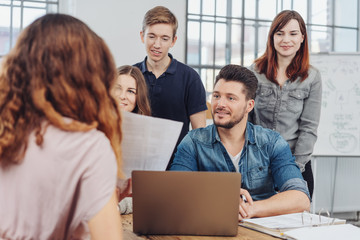 Group of businesspeople or students in a meeting
