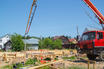 concrete pump on the site counstruction of foudation slab