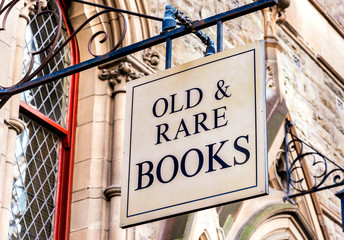 "A""Old & Rare Books"" sign in front of some victorian architecture"