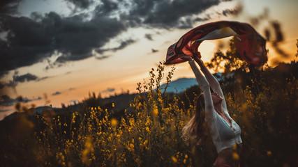 Girl dancing in a flower field