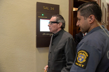 Frenchman Jean-Claude Arnault leaves the court room in the Stockholm district court after the last day of hearings in his trial for rape and sexual assault