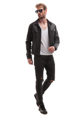 curious blonde fashion man stepping and looking to side
