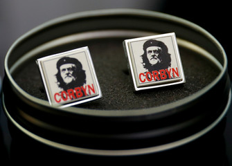 Cuff links featuring an image of Jeremy Corbyn in the style of Che Guevarra are seen for sale at the Labour Party's conference in Liverpool