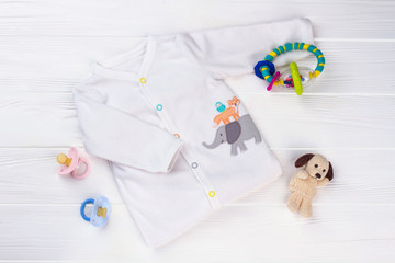 White soft baby shirt and toys.
