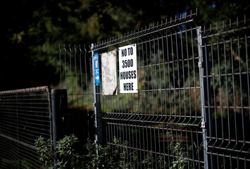 A sign protesting against a proposed housing estate hangs on an entrance to Garendon Park in Loughborough