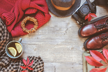 Wall Mural - autumn women fashion clothes set with cozy sweater, shoes, plaid shirt, vintage photo camera, hat and cup of tea. Fall seasonal walk concept, flat lay with empty space