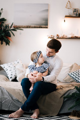 Portrait of a young attractive dad and little girl at home