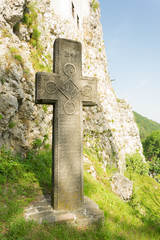 Mysterious ancient stone cross with runic symbols. Landmarks of Bran Castle, Romania