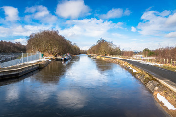 Frozen Canal in the Countryside of Scotland and Blue Sky.