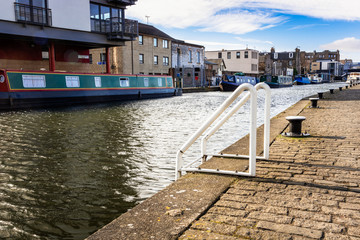 White Ladder and Bollards on a Cobblestone Quay along a Canal in Edinburgh on a Sunny Winter Morning