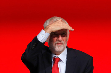 Labour Party leader Jeremy Corbyn looks out from the podium at the party's conference in Liverpool