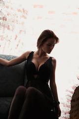 Sexy girl in vintage chair.Girl in underwear.