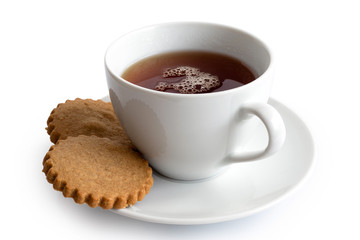 A cup of black tea with two gingerbread biscuits isolated on white. White ceramic cup and saucer.