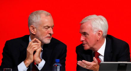 The Labour Party's shadow Chancellor of the Exchequer John McDonnell speaks to party leader Jeremy Corbyn at the party's conference in Liverpool