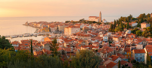 Beautiful aerial view on Piran town at the sunset, ancient buildings with red roofs and Adriatic sea in southwestern Slovenia
