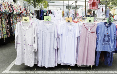 clothes stand in a street market with a large sample of nightgowns