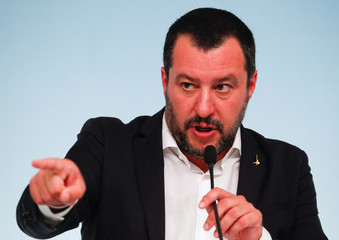 Italy's Interior Minister Matteo Salvini gestures during a news conference with Prime Minister Giuseppe Conte after to approve a new decree of the measures on immigration and security at Chigi Palace in Rome