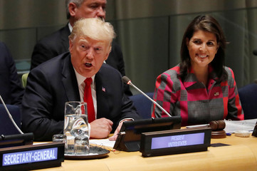 U.S. President Donald Trump speaks as U.N. Ambassador Nikki Haley looks on at United Nations Global Call to Action on the World Drug Problem during the 73rd United Nations General Assembly in New York