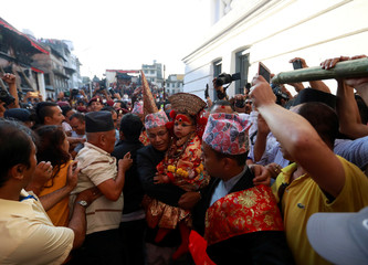 Living Goddess Kumari is carried towards her chariot during the Indra Jatra Festival in Kathmandu