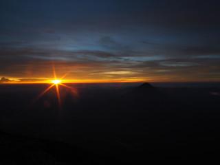 Overlooking the volcanic landscape of Guatemala during sunrise
