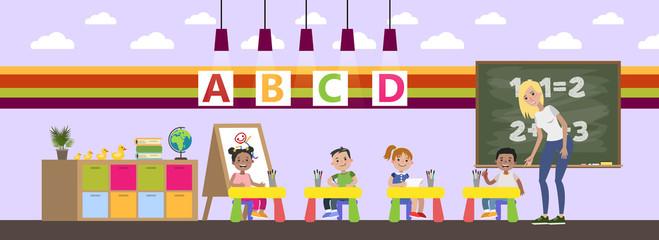 Children in kindergarten study in the classroom
