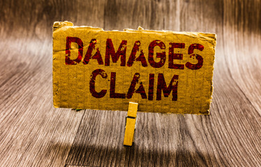 Conceptual hand writing showing Damages Claim. Business photo text Demand Compensation Litigate Insurance File Suit Paper notes reminders question mark asking important answer