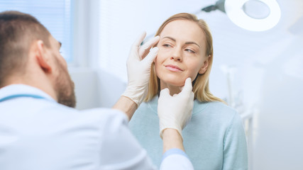 Plastic / Cosmetic Surgeon Examines Beautiful Woman's Face, Touches it with Gloved Hands, Inspecting Healed Face after Plastic Surgery with Amazing Results.