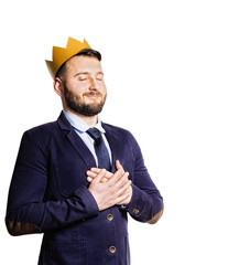 The concept of leadership, excellence. Portrait of a smiling man with a golden crown on his head. Isolated on white background.