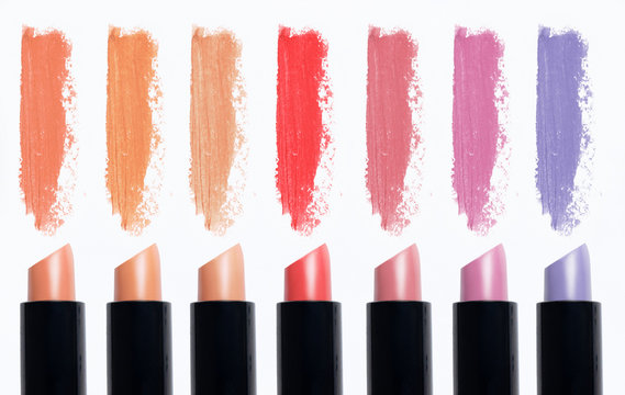 Cosmetics isolated on white background. Macro nude trend colors lipstick, strokes (smear)