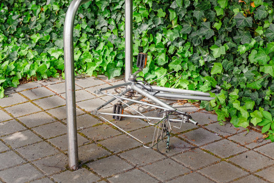 Bicycle frame without wheels, with locker lay on the street parking, stolen bicycle concept